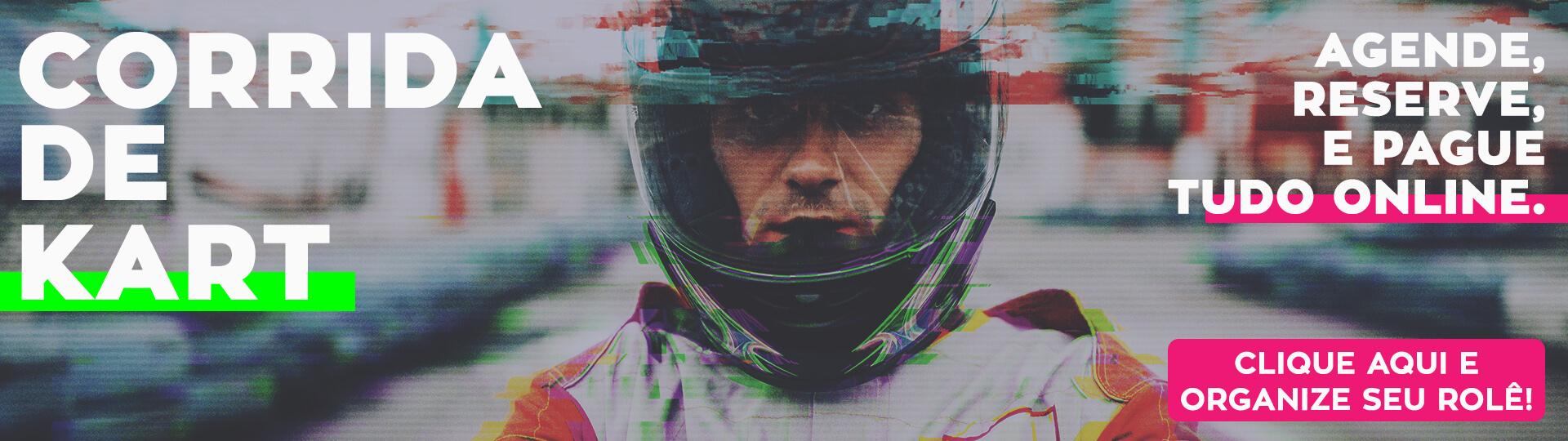"""Imagem de um piloto de kart, com o texto """"Corrida de Kart"""" na esquerda e """"Agende, reserve e pague. Faça tudo isso online."""" na direita. Também tem um texto """"clique aqui e organize seu rolê"""", no canto direito inferior, ao lado do logo do Adrena."""